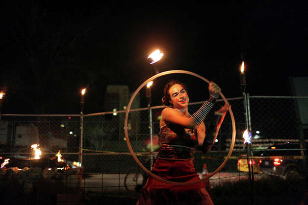 "Fire dancer Gianna ""Twirlwind"" Cox performs at Livefyre's Fyre Bash at the Fyre Pit during South by Southwest March 12, 2012, in Austin. Photo: EDWARD A. ORNELAS, Edward A. Ornelas/Express-News / © SAN ANTONIO EXPRESS-NEWS (NFS)"