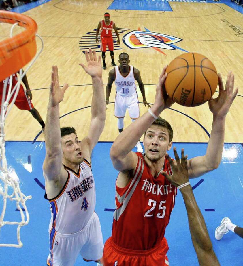Houston Rockets forward Chandler Parsons (25) shoots in front of Oklahoma City Thunder center Nick Collison (4) in the second quarter of an NBA basketball game in Oklahoma City, Tuesday, March 13, 2012. (AP Photo/Sue Ogrocki) Photo: Sue Ogrocki, Associated Press / AP
