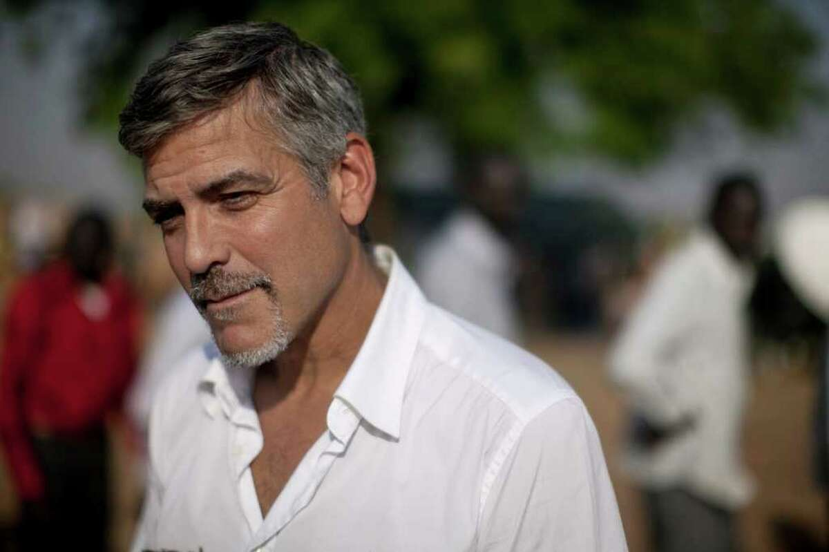 George Clooney visits a polling station on the first day secession voting, Jan. 9, 2011, in Juba, then capital of southern Sudan.