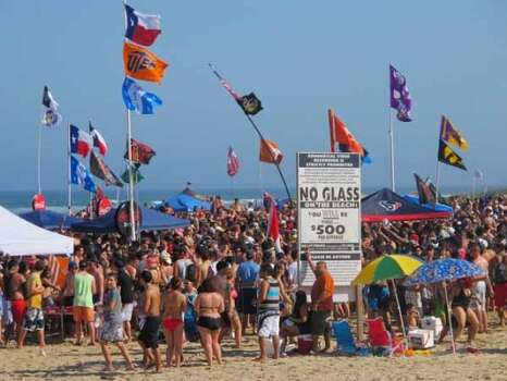 Spring breakers pack Coca-Cola Beach in South Padre Island on March 12, 2012. Guests from Isla del Sol condominiums next door can watch 10,000 students cover the beach during Texas week when the state's schools are on break. City officials say hotel occupancy is at 95 percent for Texas week. (Chris Sherman / Associated Press)