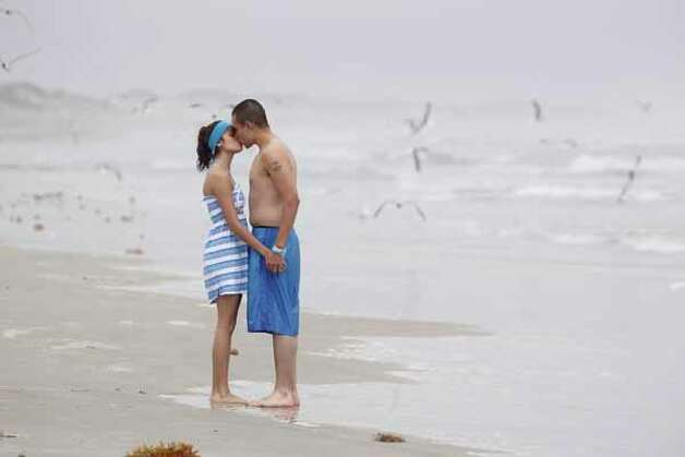 Olga Morales, 17, and her boyfriend, Jose Diaz, kiss on a foggy beach March 12, 2012, on Padre Island in Corpus Christi. Photo: Michael Zamora, Associated Press / Corpus Christi Caller-Times
