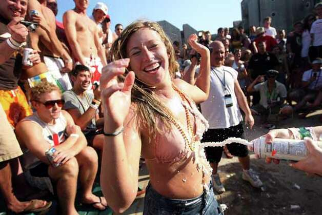 Students participate in a whipped cream contest at the MTV Beach Bash party put on by Global Groove at the Bahia Mar Hotel on March 26, 2008, on South Padre Island. Photo: Rick Gershon, Getty Images / Getty Images North America