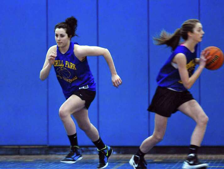 Averill Park basketball player Elaina Ryan, left, and her teammates prepare for their Class A semifi