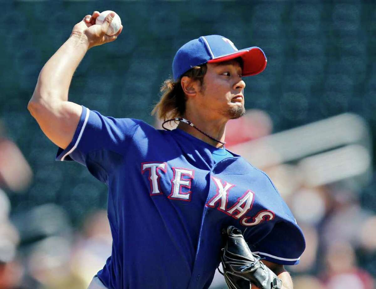 The Rangers' Yu Darvish allowed two runs in three innings Tuesday in his second spring start.