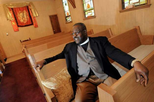 Rev. Eloy Binnon talks about his church facing foreclosure on Tuesday, March 13, 2012, at New Creation in Christ Ministries in Schenectady, N.Y. The city sold the liens to a collection agency, even though the church is a nonprofit and isn't required pay taxes. (Cindy Schultz / Times Union) Photo: Cindy Schultz / 00016793A