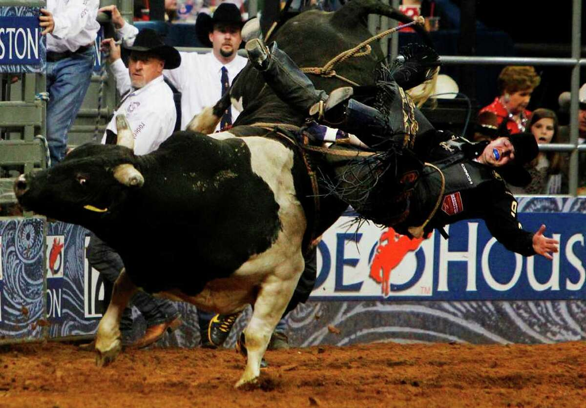 Clayton Foltyn takes a hard spill in Tuesday's bull riding competition.