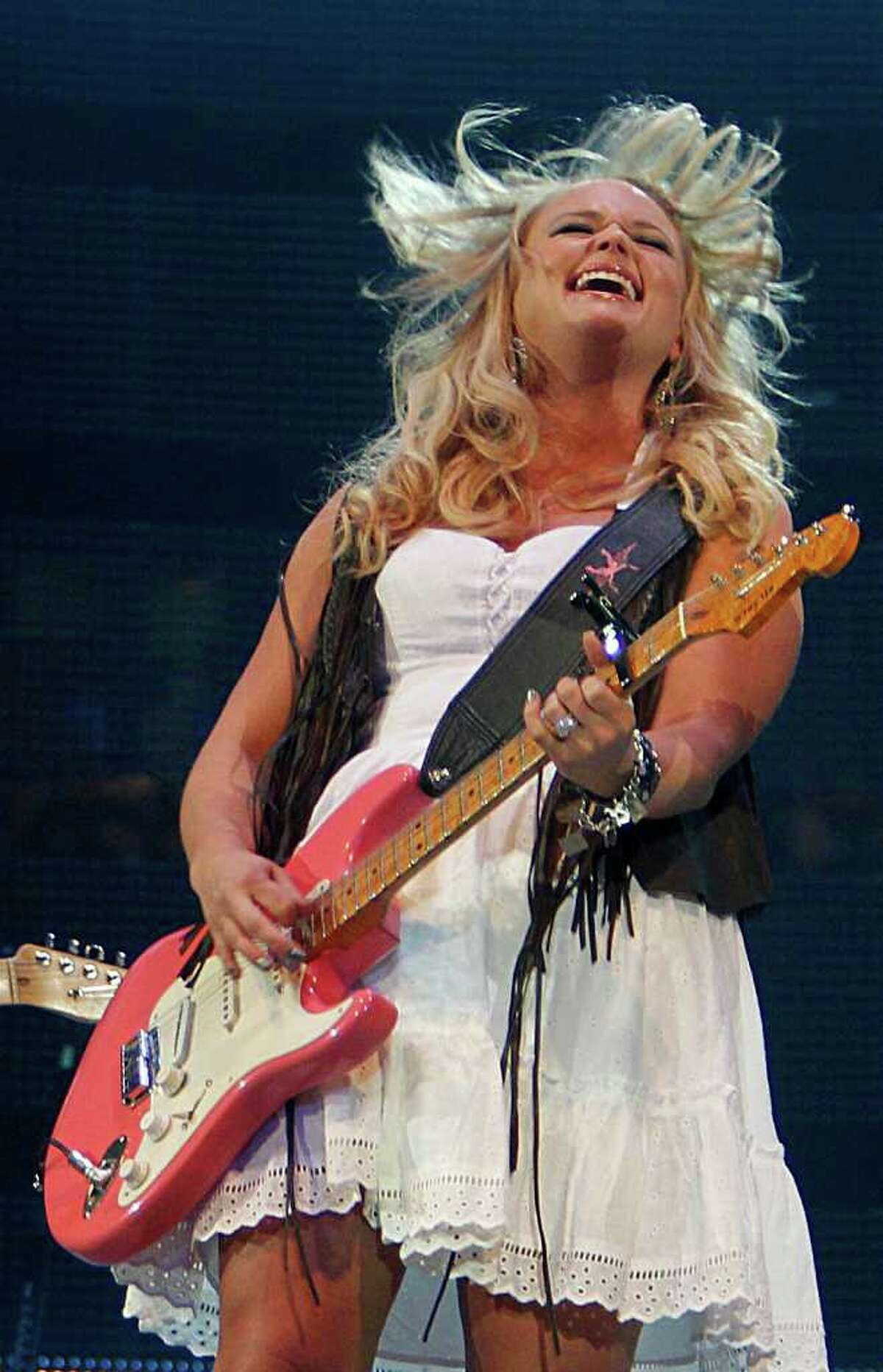 """Miranda Lambert urges the Houston Livestock Show and Rodeo crowd Tuesday to """"rock a little harder"""" than they did when husband Blake Shelton was here."""