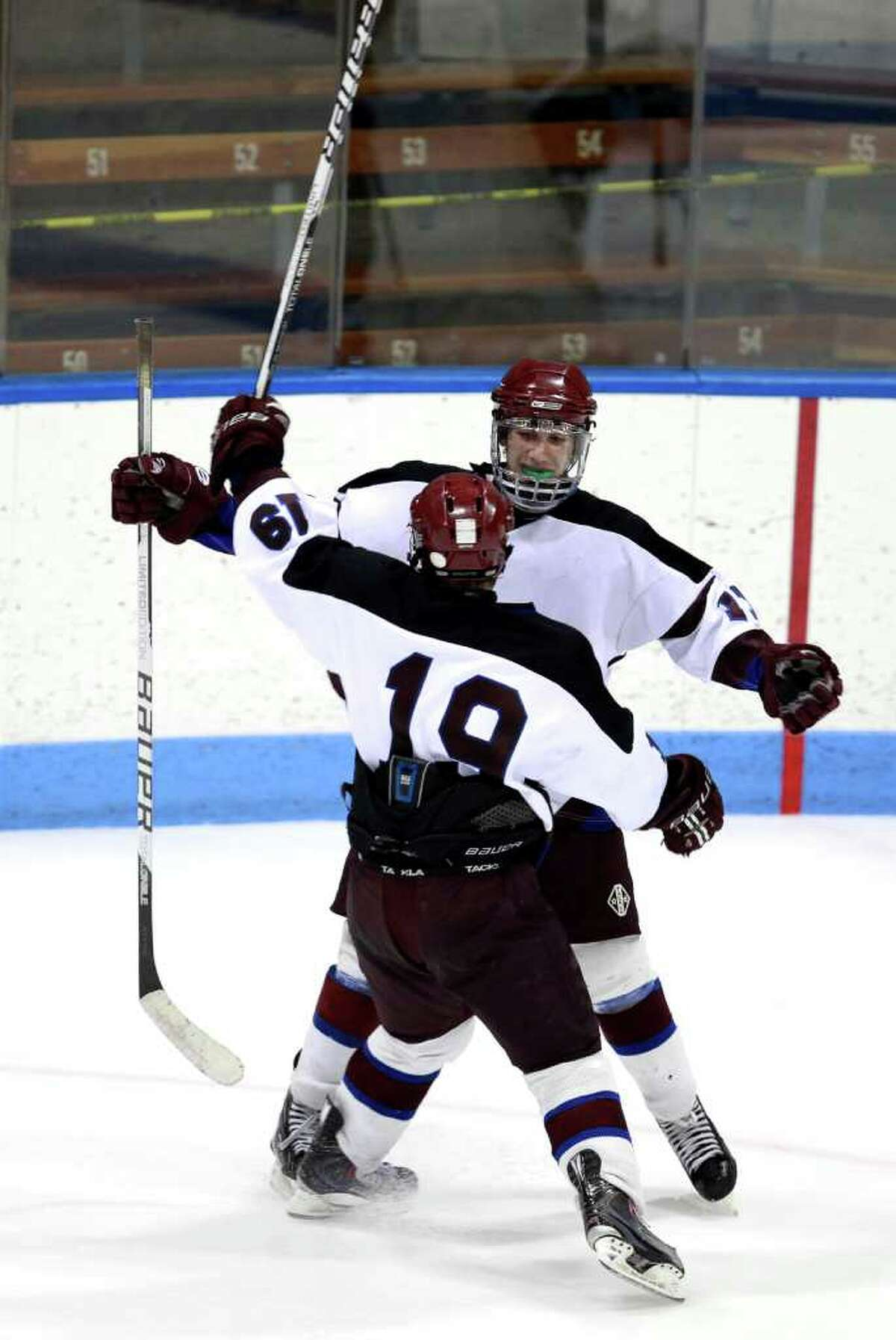 Brookfield/Bethel/Danbury's # 11 Steven Hallock and teammate #19 Nick Melvin celebrate after Hallock's first period goal during Division III hockey semi-finals against Northwest Catholic on Tuesday March 13, 2012, in New Haven, Conn.