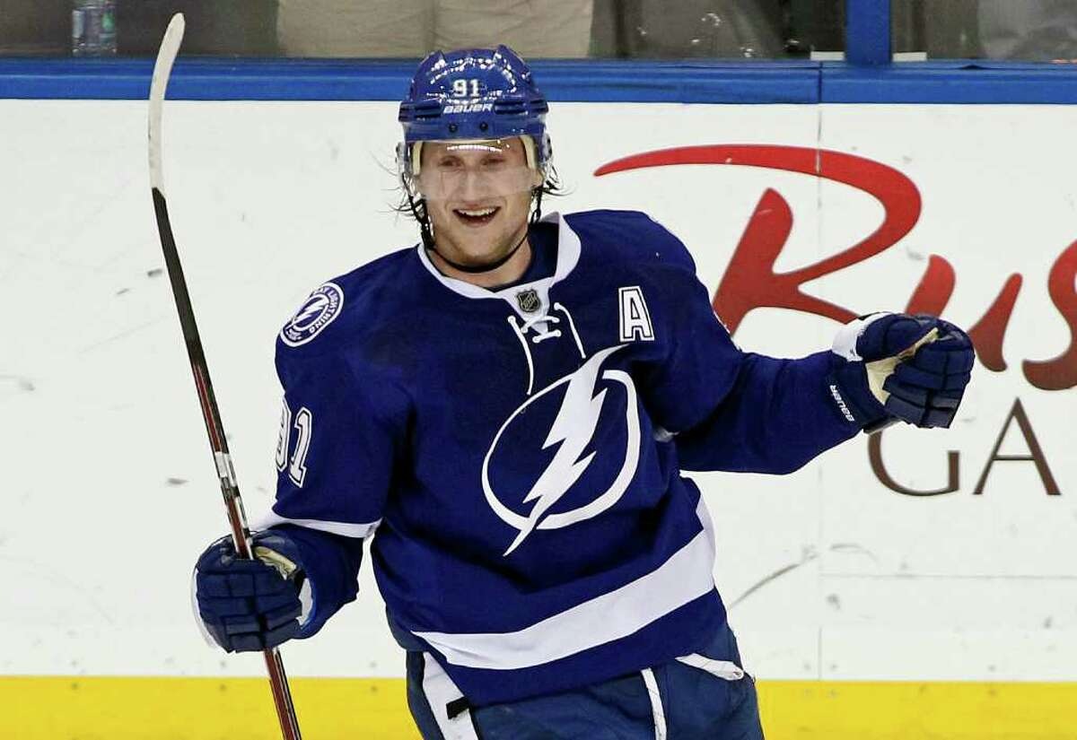 Tampa Bay Lightning's Steven Stamkos celebrates his 50th goal of the season, during the third period of an NHL hockey game against the Boston Bruins on Tuesday, March 13, 2012, in Tampa, Fla. The Lightning won 6-1. (AP Photo/Mike Carlson)