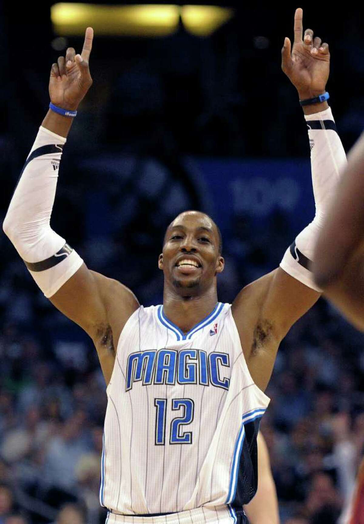 Orlando Magic center Dwight Howard celebrates after making a foul shot in overtime of an NBA basketball game against the Miami Heat in Orlando, Fla., Tuesday, March 13, 2012. The Magic won 104-98.