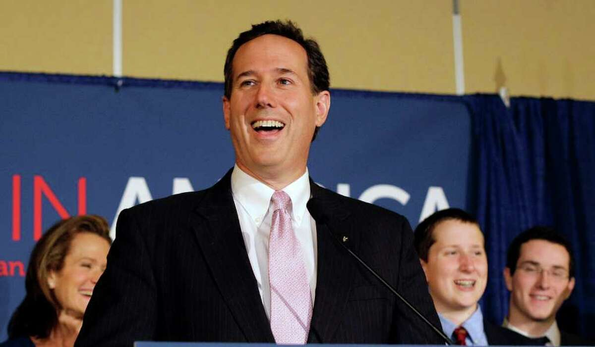Rick Santorum, celebrating with supporters in Lafayette, La., on Tuesday, overcame Mitt Romney's war chest and Newt Gingrich's Southern strategy to win Alabama and Mississippi.