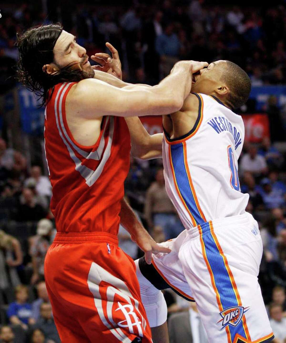 Much like the rebounding confrontation between Luis Scola, left, and Thunder guard Russell Westbrook, the Rockets went toe-to-toe with the Western Conference's top team and emerged a winner.