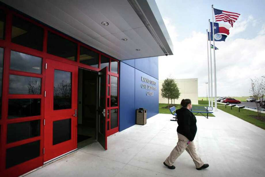 Members of the media tour of the new Karnes County Civil Detention Center, in Karnes City, on Tuesday, March 13, 2012. Photo: Bob Owen, San Antonio Express-News / © 2012 San Antonio Express-News