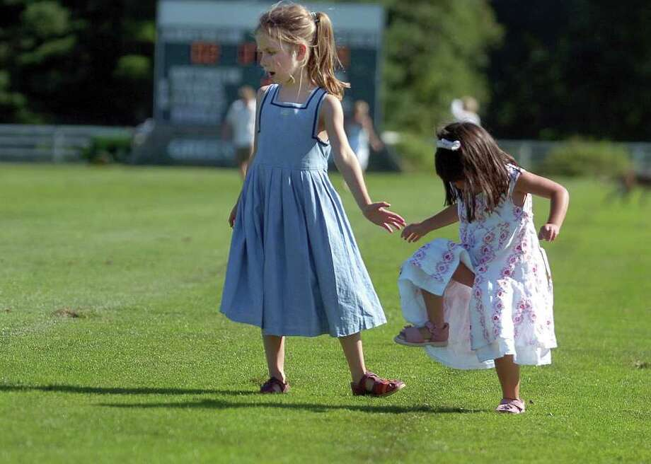 ...you've stomped divots at polo. Photo: Helen Neafsey, Greenwich Time / Greenwich Time