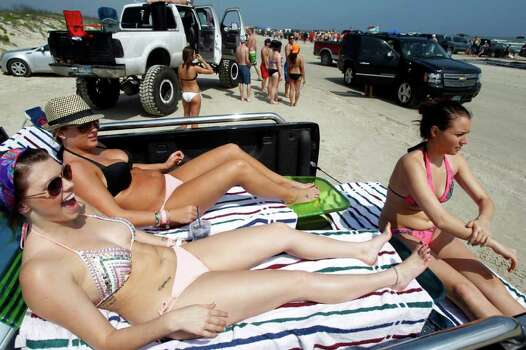 From left, Sarah Stanley of Dallas, Kadie Durham of Houston and Shannon Rios of Katy, Texas, get some sun in the back of their truck, Tuesday, March 13, 2012 on the beach in Port Aransas, Texas. (AP Photo/Corpus Christi Caller-Times, Michael Zamora)MANDATORY CREDIT Photo: Michael Zamora, Associated Press / AP2012