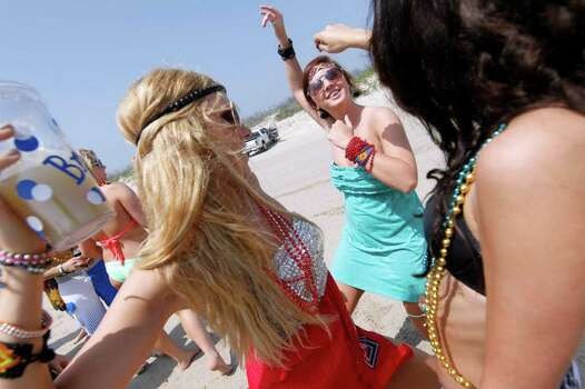 From left, Brooke Bryant, Ashton Ermis and Olivia Grace, all students from Texas Tech University, dance togetherTuesday, March 13, 2012 on the beach in Port Aransas, Texas. (AP Photo/Corpus Christi Caller-Times, Michael Zamora)MANDATORY CREDIT Photo: Michael Zamora, Associated Press / AP2012