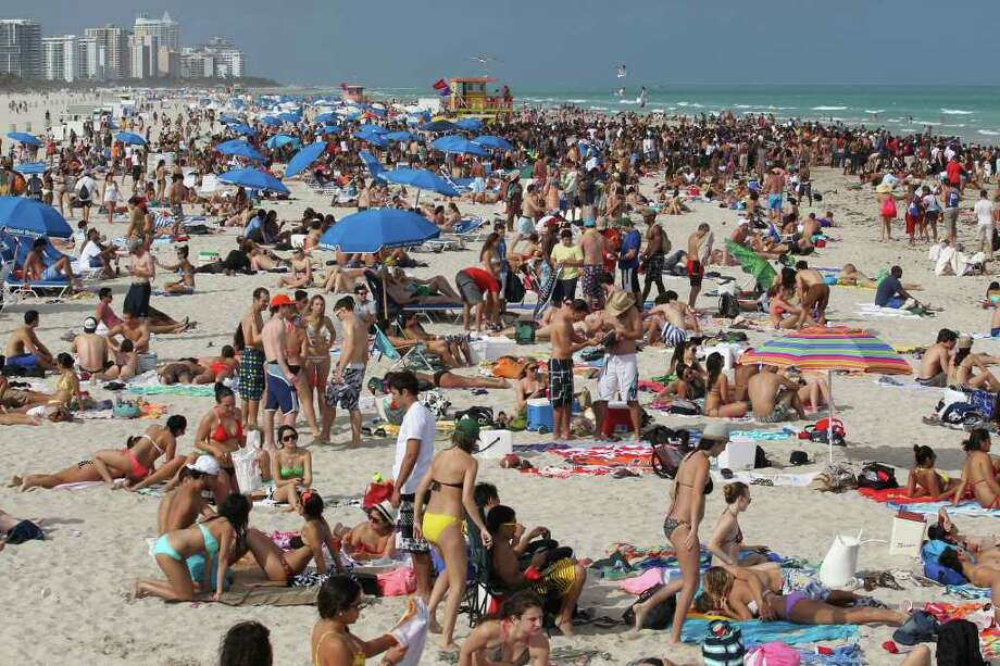 Miami is a hot spot for Spring Break for the awesome beaches and night life. Miami is so cool Will Smith even wrote a song about it.  Photo: Al Diaz, Associated Press / The Miami Herald