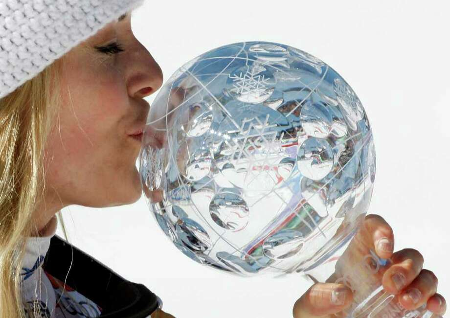Lindsey Vonn, of the United States, kisses the trophy of the alpine ski, women's World Cup downhill discipline title, in Schladming, Austria, Wednesday, March 14, 2012. Photo: Armando Trovati, Associated Press / AP