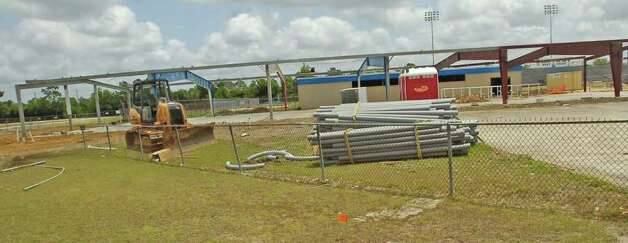 A federal judge has ordered that work on the West Brook Field House, now nothing more then a skeleton and a slab, stop because the district improperly awarded the bid to a contracting company that was not the highest ranked.    Dave Ryan/The Enterprise