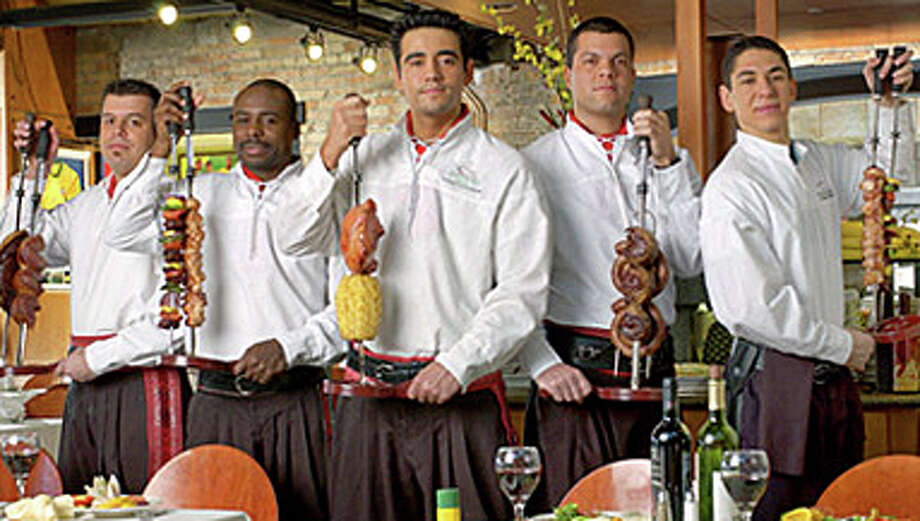 Rodizio Grill offers over a dozen rotisserie grilled meats, seasoned and carved tableside by Brazilian Gauchos. Photo: Contributed Photo