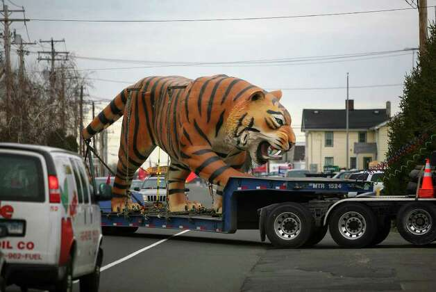 One of a pair of giant fiberglass tigers is delivered to Show Motion, Inc. at 950 Bridgeport Avenue in Milford on Tuesday, February 14, 2012. The tigers, which are being refurbished by the Milford company, normally reside high atop the scoreboard at Comerica Park in Detroit, Michigan, home of the Detroit Tigers baseball team. Photo: Brian A. Pounds / Connecticut Post