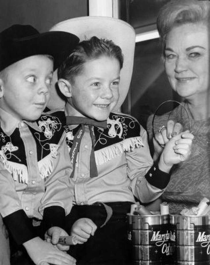 Donald Carrow, 4, and brother Dennis, 6, sons of Mrs. and Mrs. Pat Carrow, had been saving their pennies for the rodeo in 1968. The lady operating the box office at the Domed Stadium was their grandmother, Mrs. Mabel Martin.   (LARRY EVANS / Houston Chronicle)