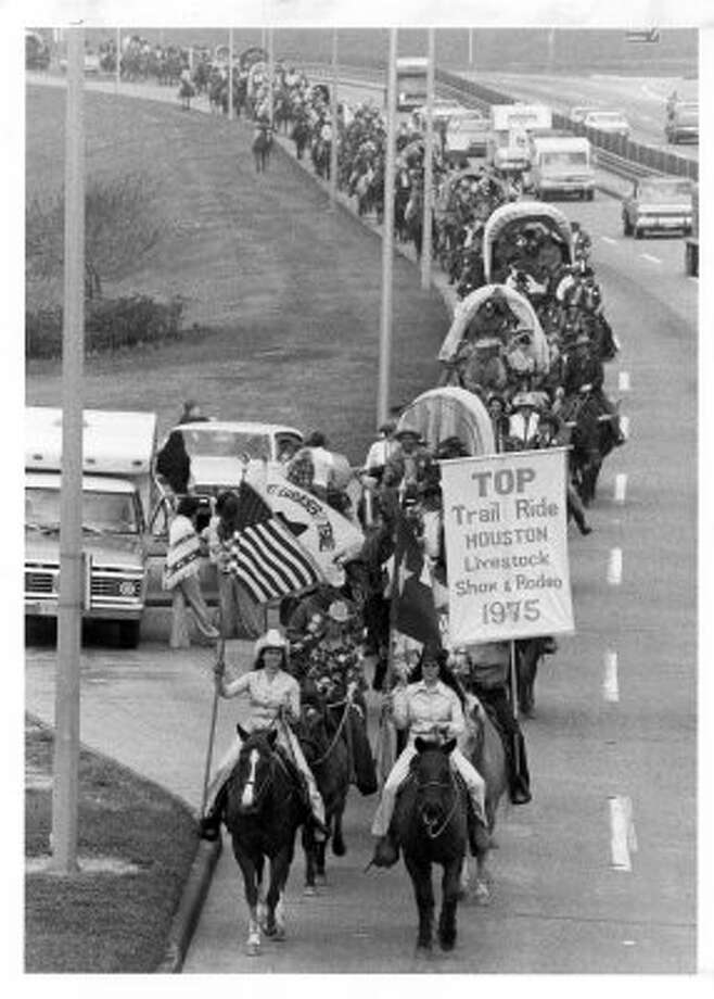 Members of the Salt Grass Trail clop along Memorial Drive near Studemont overpass. (02/21/1975) (DARRELL DAVIDSON / Houston Chronicle)