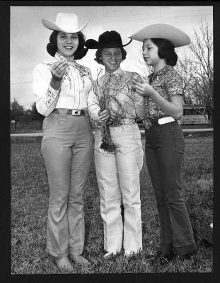 Benita Brown, left, made history in 1963 when she became the first girl contestant in the rodeo grass judging contest. (12/27/64) (UNKNOWN / HOUSTON CHRONICLE)