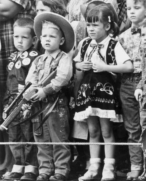 Kids watch the rodeo parade in downtown Houston on Feb. 22, 1962. (Houston Chronicle)