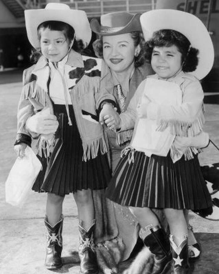 Dale Evans with her children, Dody, left, and Debby, right. (02/25/1957) (Houston Chronicle)