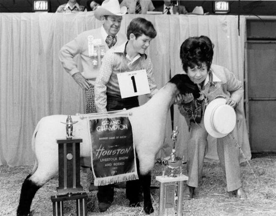 This lamb named Crazy didn't need a costume.  Owned by young Bret Allen of Boerne, it was purchased by Hazel Herrin for a record-breaking $8,025.  Hazel's husband, Bob Herrin, the Stock Show's permanent ambassador-at-large, is standing in the background. (03/05/1975) (DARRELL DAVIDSON / HOUSTON CHRONICLE)