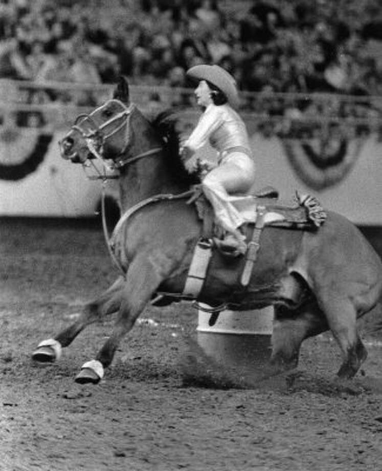 HOUCHRON CAPTION (02/25/1968):  Faye Faullin of Greenville, Ala., Saturday's barrel racing leader, maneuvers her horse around a barrel during her 18.86-second run at the Houston Livestock Show and Rodeo.  BLAIR PITTMAN/HOUSTON CHRONICLE. (BLAIR PITTMAN / HOUSTON CHRONICLE)