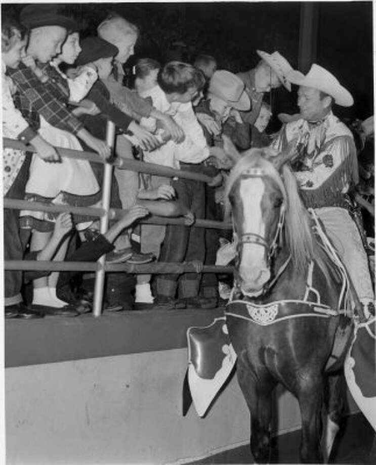 Young fans got to see their hero, Roy Rogers, up close on his equally famous horse, Trigger, at the 1957 Houston Fat Stock Show, now called the Houston Livestock Show and Rodeo. (Houston Chronicle)