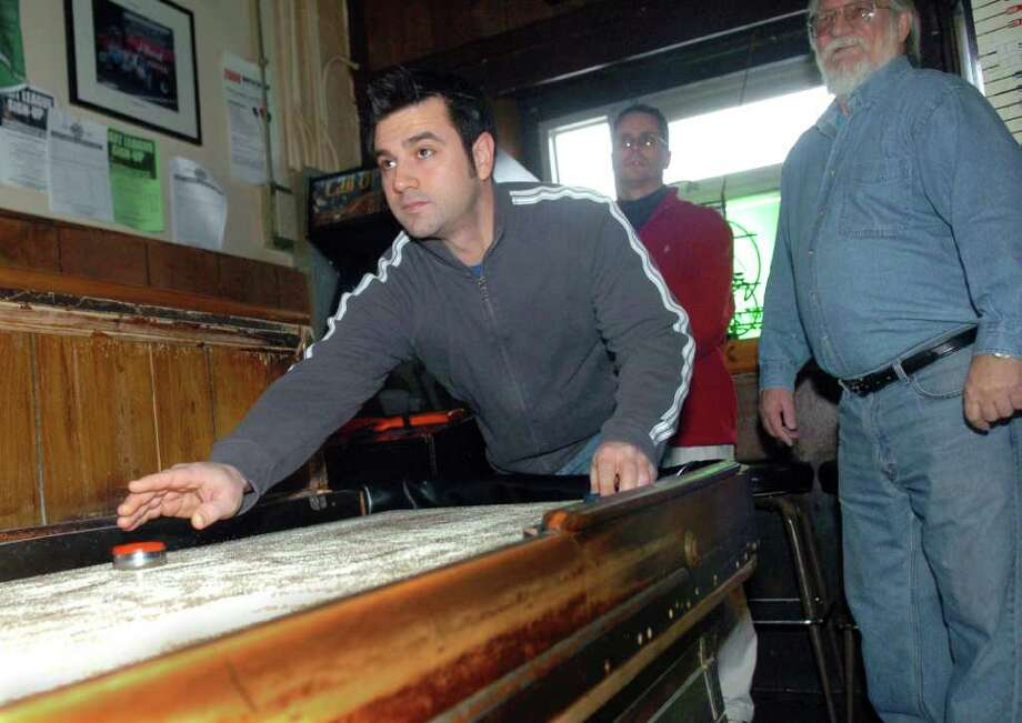 ...you've played shuffleboard at Bruce Park Grill. Photo: Helen Neafsey, Greenwich Time / Greenwich Time