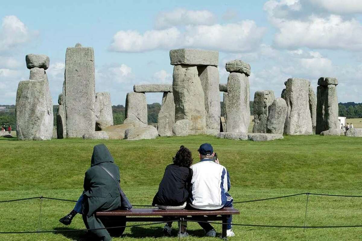 This is a Sept. 15, 2004. file photo of tourists looking at The Stonehenge on Salisbury Plain in England. Scientists scouring the area around Stonehenge said Thursday July 22, 2010 they have uncovered the foundations of a second circular structure only a few hundred meters (yards) from the world famous monument.