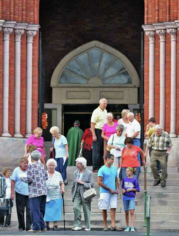 Parishioners leave St Patrick's church in Watervliet Saturday Sept. 24, 2011, after one of the last masses at the church before it closed.  (John Carl D'Annibale / Times Union archive) Photo: John Carl D'Annibale / 00014733A