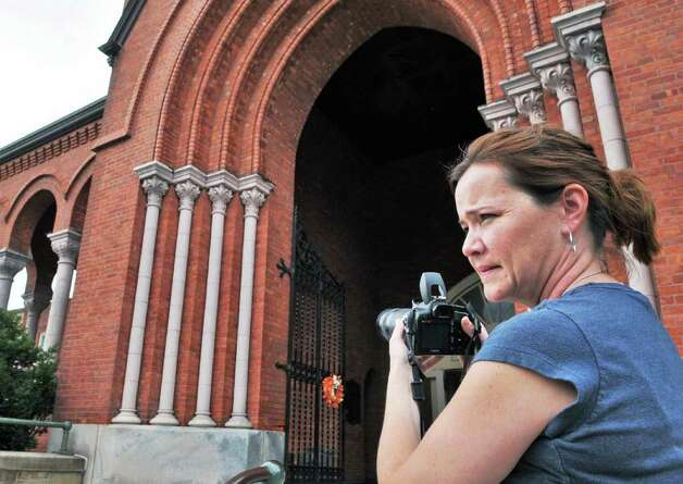 Life-long parishioner of St Patrick's church in Watervliet Sarah Donlon of Latham takes photos outside the church Saturday Sept. 24, 2011. Sarah's family had been members of the church since it opened, and she was to overcome with emotion to attend Saturday's services.   (John Carl D'Annibale / Times Union archive) Photo: John Carl D'Annibale / 00014733A