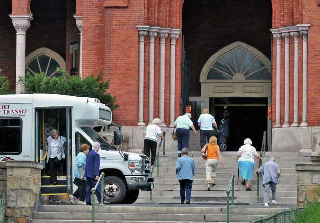 Parishioners arrive at  St. Patrick's church in Watervliet Saturday Sept. 24, 2011, for one of the last masses at the church.  (John Carl D'Annibale / Times Union archive) Photo: John Carl D'Annibale / 00014733A