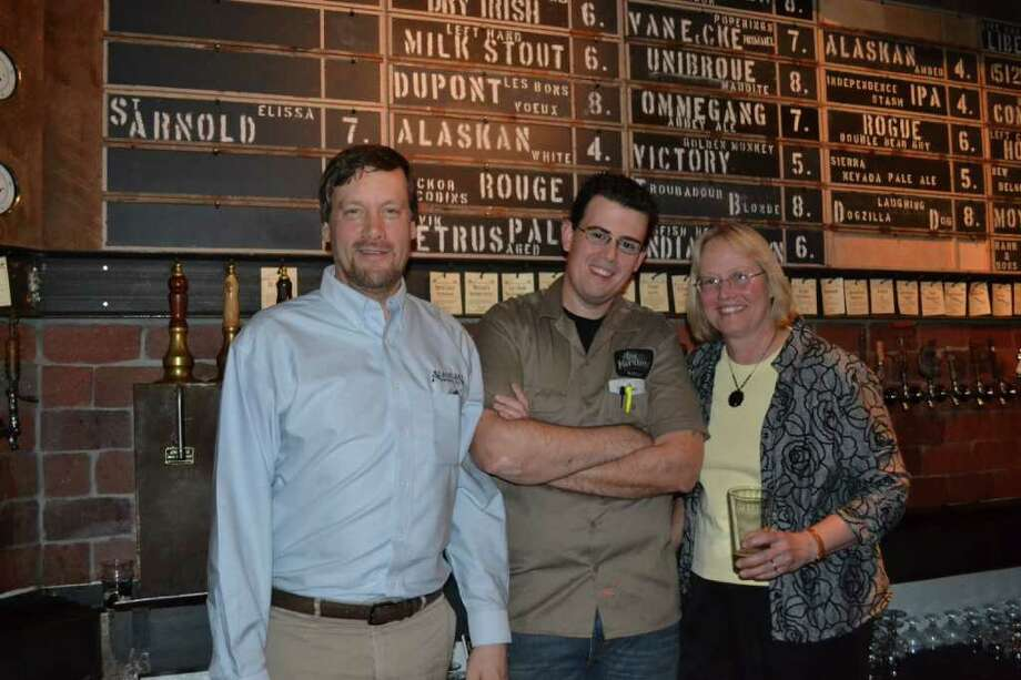 When Geoff Larson, left, and his wife, Marcy, founded Alaskan Brewing Co. 25 years ago, it became just the 67th U.S. brewery. This past week, they celebrated the debut of their beers in Houston at Hay Merchant with Hay Merchant's managing partner Kevin Floyd, center. Photo: Ronnie Crocker
