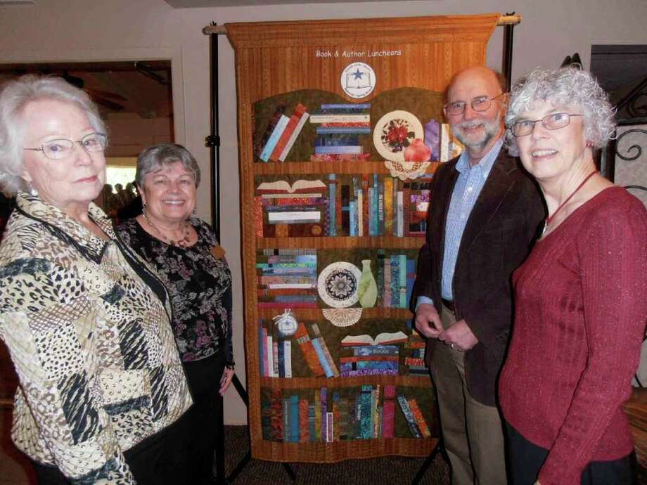 Bev Lemes, from left, Mary Lu Zellers, author Stephen Harrigan and Marykaye Morgan show a quilt incorporating spines from books the Friends of the Bulverde/Spring Branch Library has featured in its seven book and author luncheons.