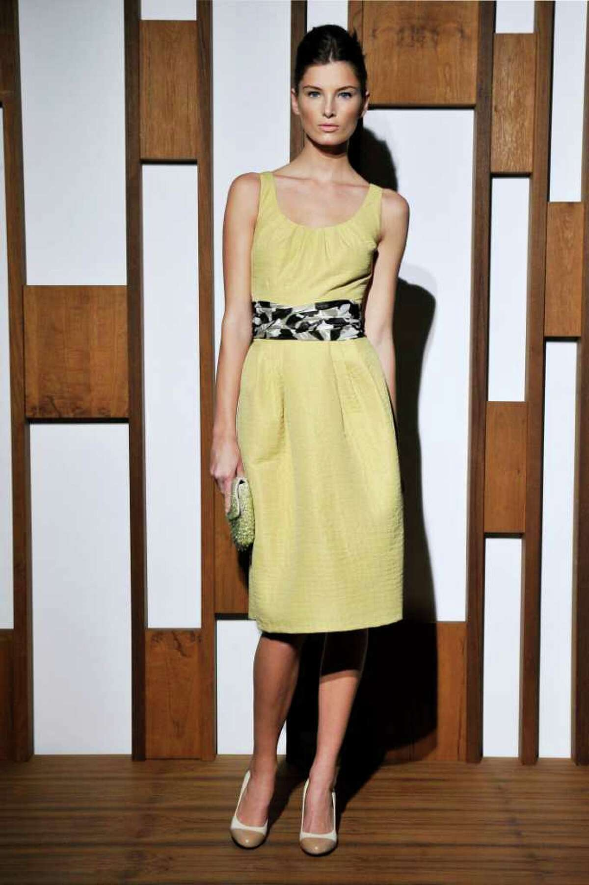 Banana Republic offers a pale yellow sheath dress for spring.