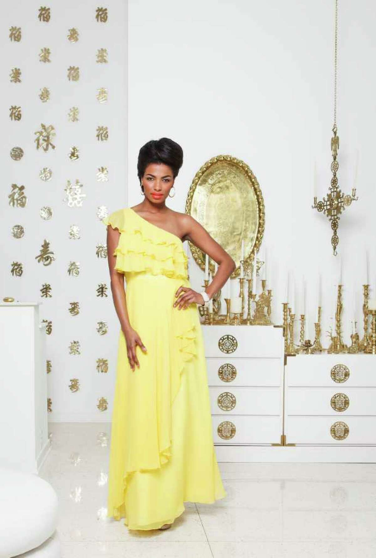 1. Clanay Wheeler of Neal Hamil Agency is wearing a yellow Jill Stuart dress, $398, with a Natasha rhinestone ring, $58, and earrings, $24; All from Dillard's. Her bracelet is Alexis Bittar, $295, from Neiman Marcus. Shoes are by Pelle Moda, $xx, Dillard's. Fashion styling by Wendy Norwood. Makeup by Tanya Robertson. Hair by Gayla Belay-Iyamu. Wednesday, Feb. 29, 2012, in Houston. ( Michael Paulsen / Houston Chronicle )