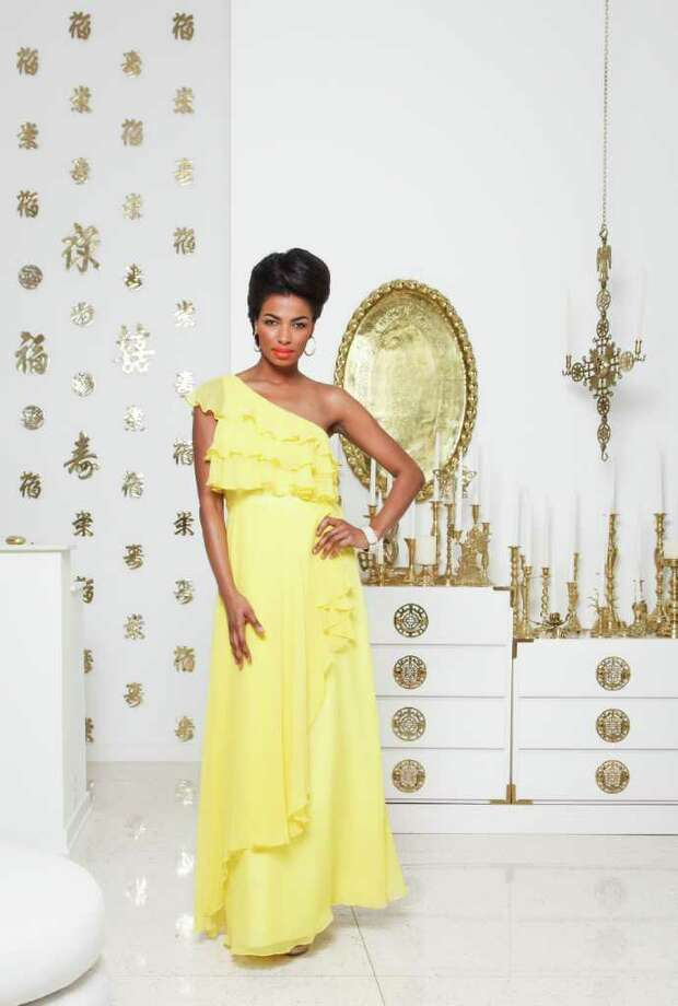 1. Clanay Wheeler of Neal Hamil Agency is wearing a yellow Jill Stuart dress, $398, with a Natasha rhinestone ring, $58, and earrings, $24; All from Dillard's. Her bracelet is Alexis Bittar, $295, from Neiman Marcus. Shoes are by Pelle Moda, $xx, Dillard's. Fashion styling by Wendy Norwood. Makeup by Tanya Robertson. Hair by Gayla Belay-Iyamu.  Wednesday, Feb. 29, 2012, in Houston.   ( Michael Paulsen / Houston Chronicle ) Photo: Michael Paulsen, Staff / © 2012 Houston Chronicle