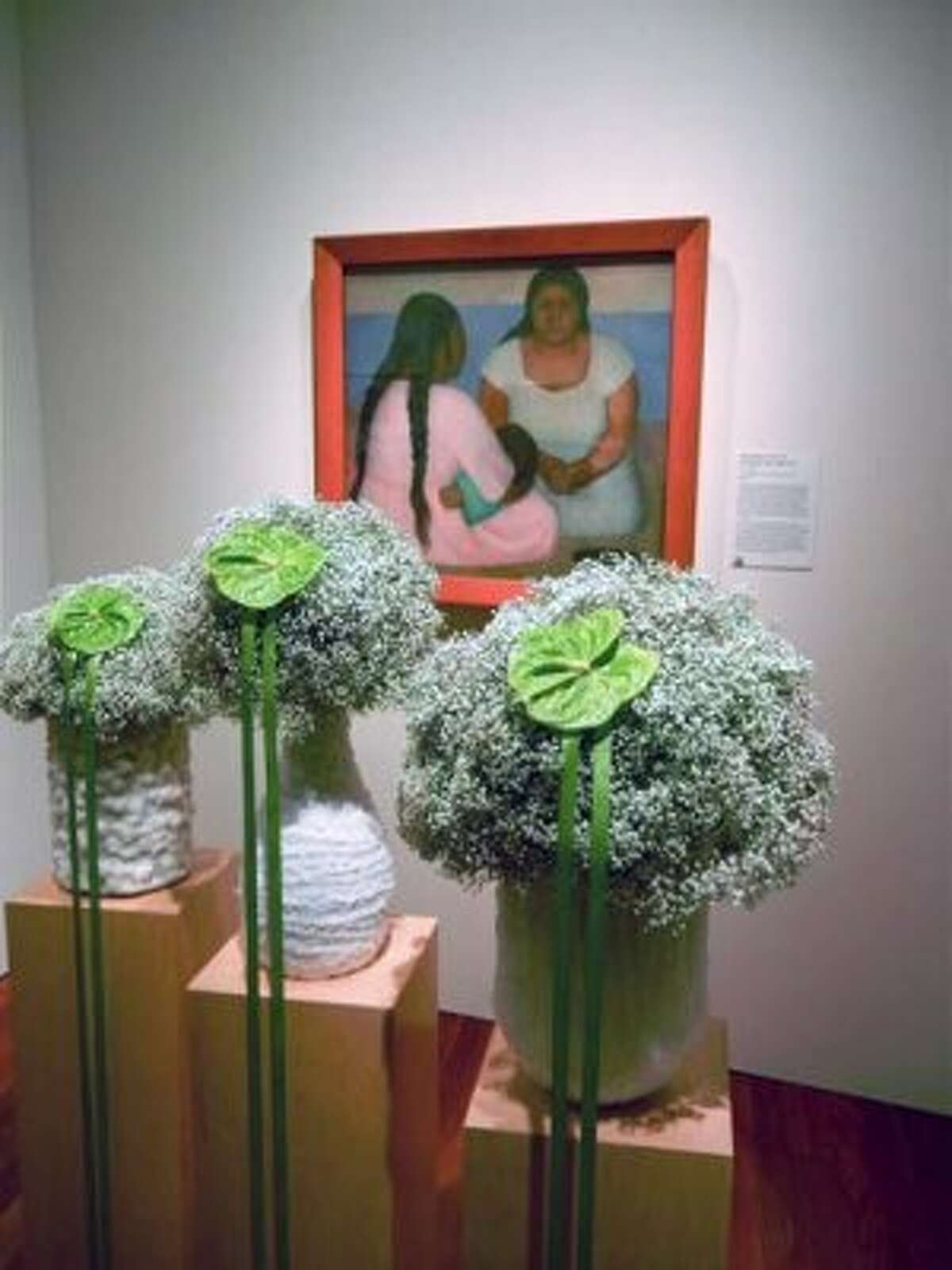 """Raul Anguiano's """"Untitled (Seated Girl Holding an Apple)"""" interpreted by Katharina Stuart Floral Art & Design in homage to the late floral designer Tamara Stevens (Catherine Bigelow)"""