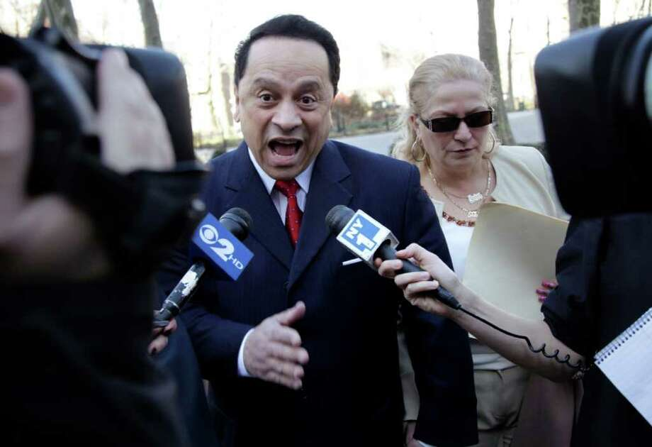 Pedro Espada, Jr. arrives to court with his wife Connie Espada in New York, Wednesday, March 14, 2012. Former state senator Pedro Espada Jr. is facing embezzlement charges involving his health care clinics in a federal trial.  (AP Photo/Seth Wenig) Photo: Seth Wenig