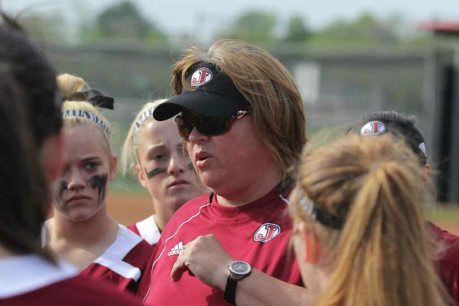 Val Weldon talks to her troops before the start of the game with Kirbyville. Photo: Jason Dunn