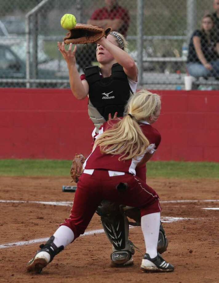 Ashley Clark and Kahla Street collide on a foul ball during the Kirbyville game. Photo: Jason Dunn