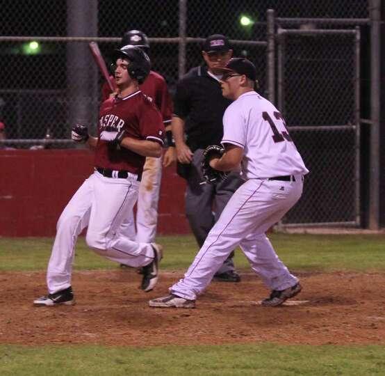 Matt Perdue scores a run on a wild pitch against Kirbyville.