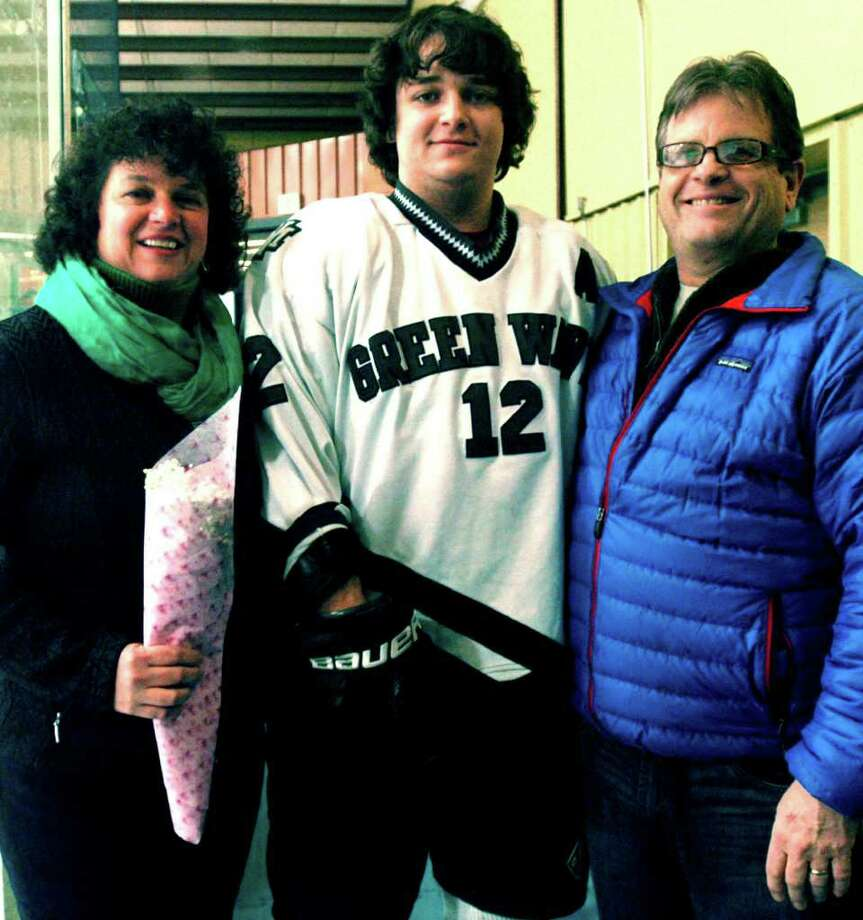 "'Senior Night'  SPECTRUM/Each of the varsity sports teams at New Milford High School has celebrated its own edition of ""Senior Night"" in recent weeks. It was the Green Wave ice hockey's turn Friday at Canterbury School as Josh Hook, shown here with his parents, Renee and Douglas, and his fellow seniors were honored by teammates and fans before their final home game.  Coach Dan Moore's skaters responded with a 5-2 victory over New Fairfield/Immaculate to qualify for the South-West Conference and CIAC state tournaments. The Green Wave was slated to play Bethel/Brookfield/Danbury Thursday in the SWC Division II semifinals in Danbury. The final is set Saturday. For the story and more photos, see the Spectrum's March 9 edition. Photo: Norm Cummings"
