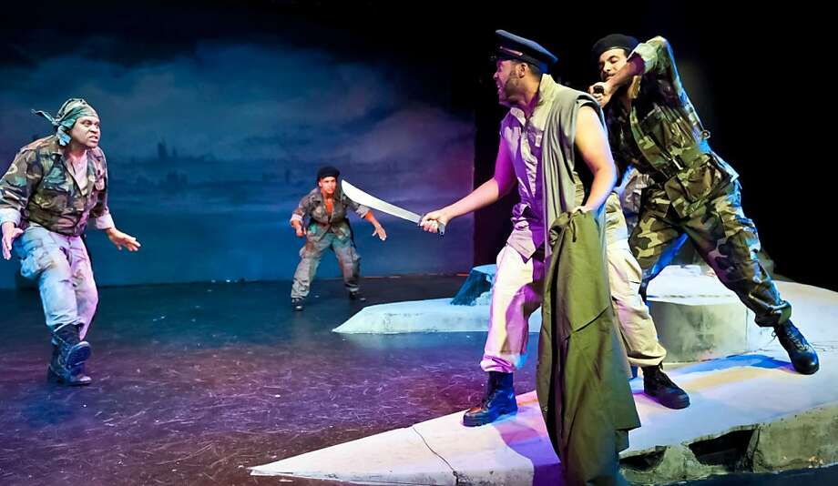 """Caesar (L. Jeffrey Moore, front right) is attacked by Cassius (B. Chico Purdiman, left), a conspirator  (Tristan Cunningham) and Brutus (David Moore) in African-American Shakespeare Company's """"Julius Caesar"""" Photo: Lance Huntley"""